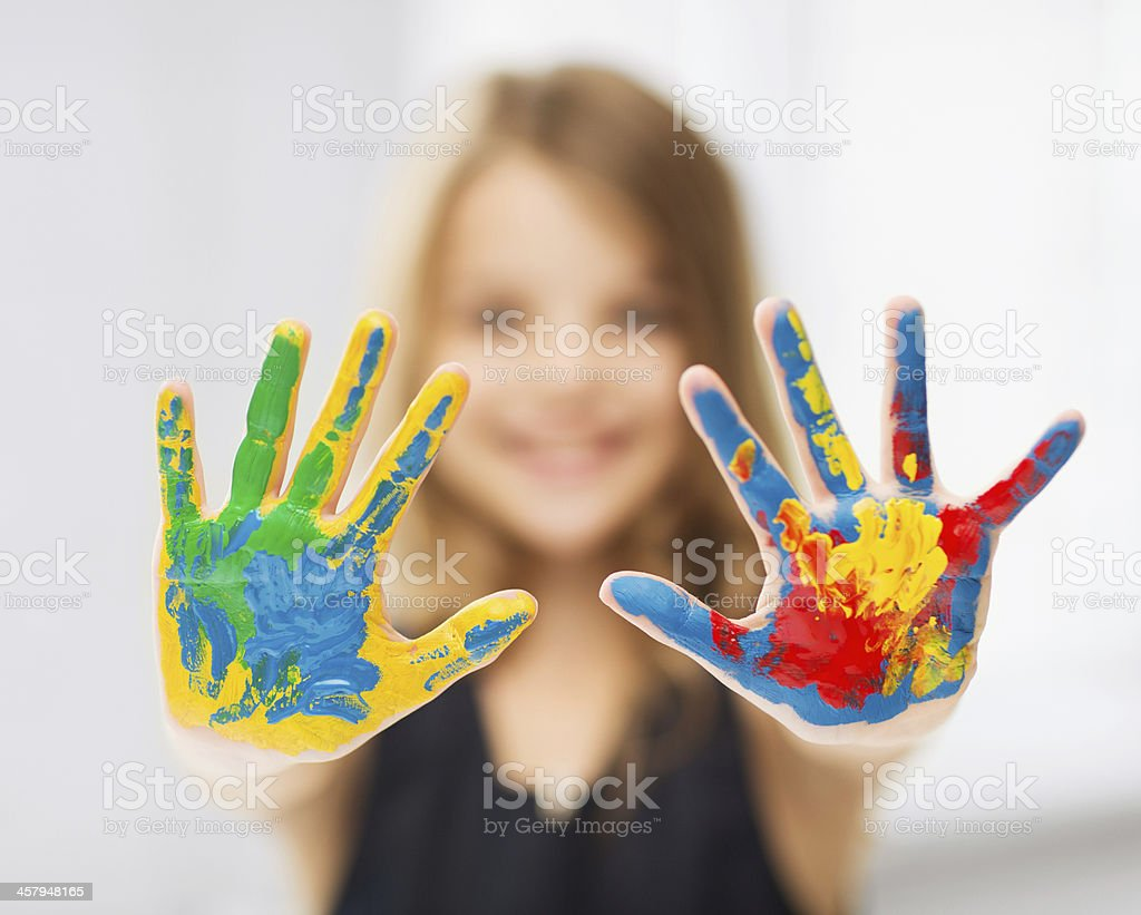 A young girl with paint on her hands stock photo