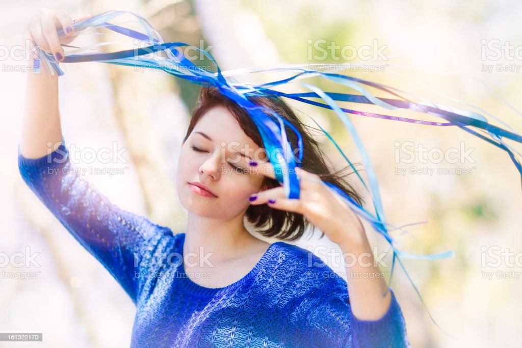 Young girl with ribbons in the wind, enjoying royalty-free stock photo