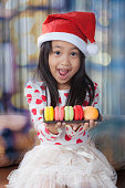 Young girl with santa hat, Christmas.