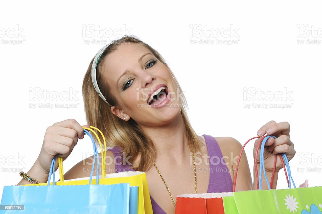 Young girl with shopping bags showing excitement royalty-free stock photo