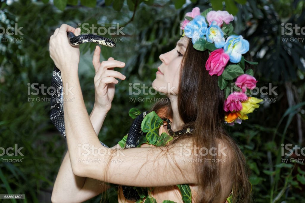 Young girl with snake stock photo
