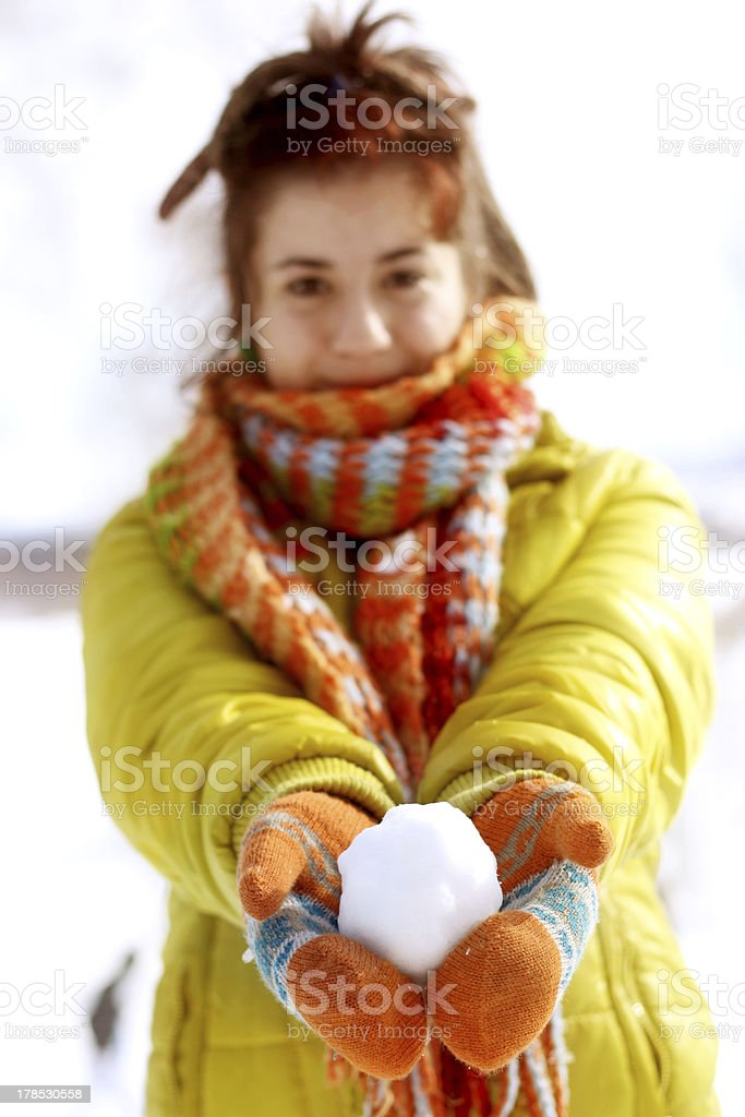 Young girl with snowball royalty-free stock photo