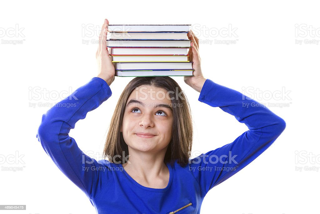 Young girl with stack of books on her head stock photo