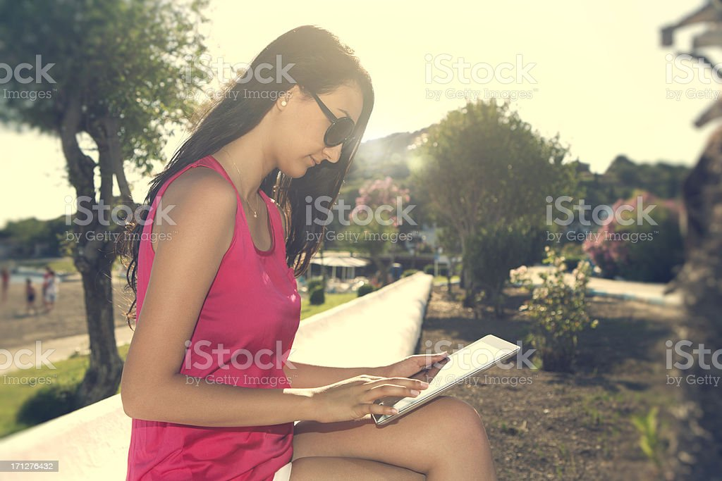 Young girl with tablet PC. stock photo