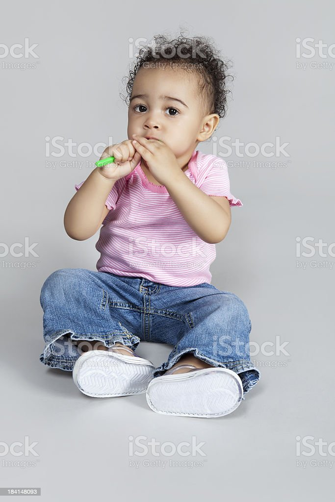 young girl with toothbrush royalty-free stock photo