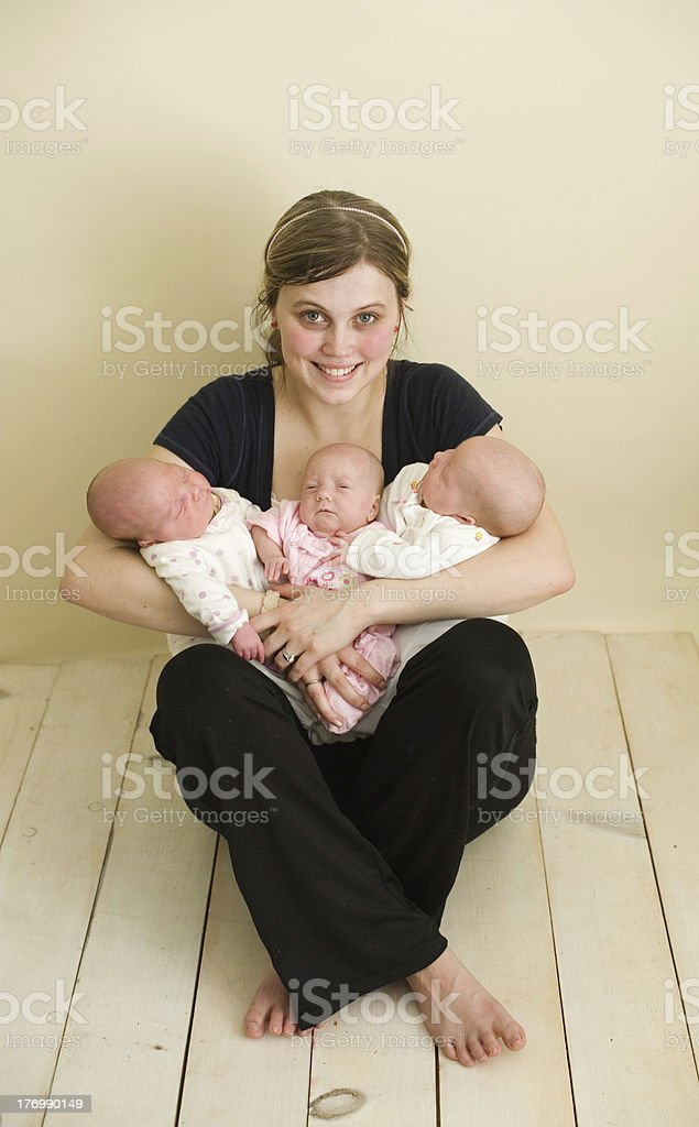 Young Girl with Triplets stock photo