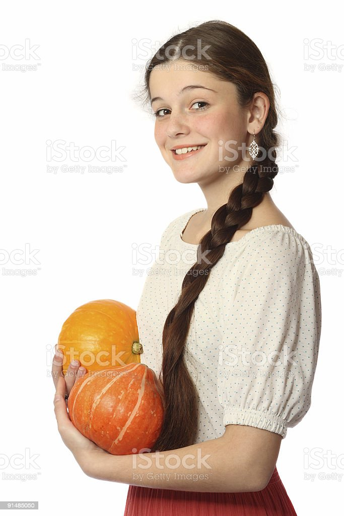 Young girl with two pumpkins royalty-free stock photo