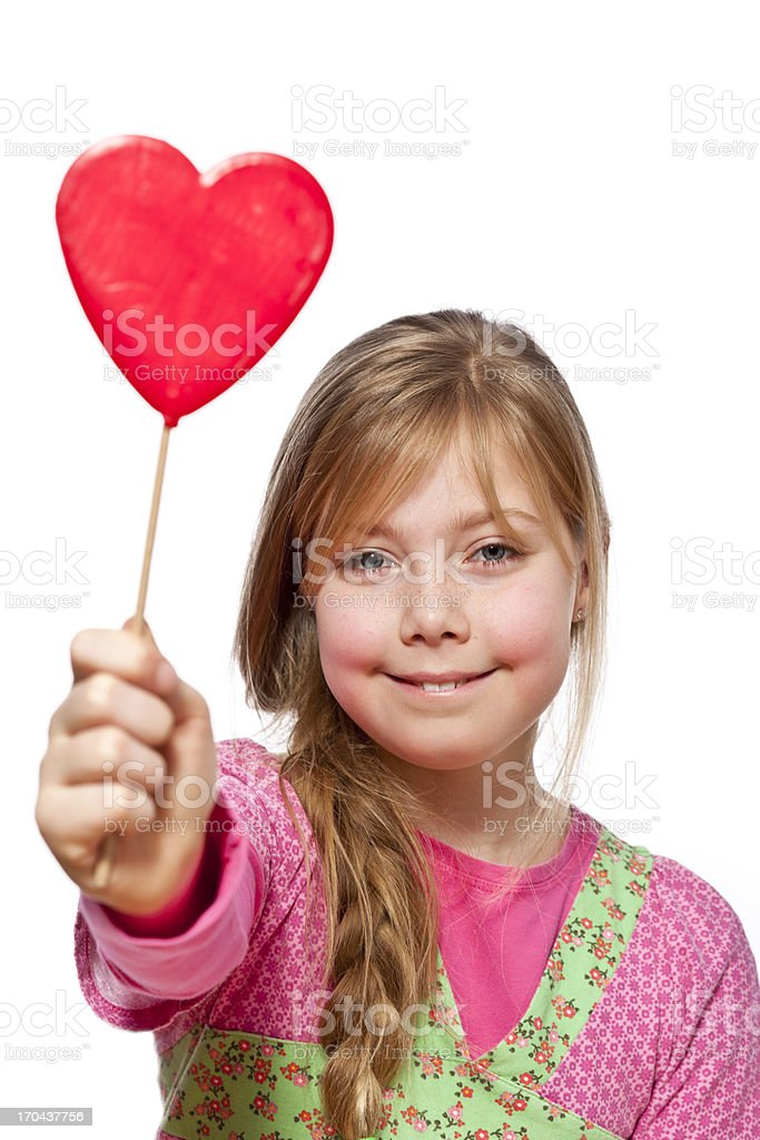 Young girl with valentine heart candy stock photo