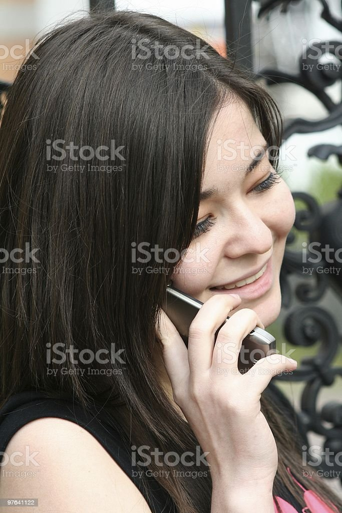 young girl with your mobile phone royalty-free stock photo