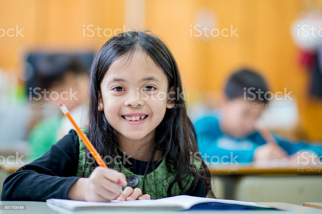 Young Girl Working in Her Notebook stock photo