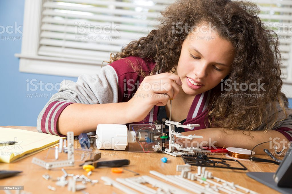 Young Girl Works on Science Project stock photo