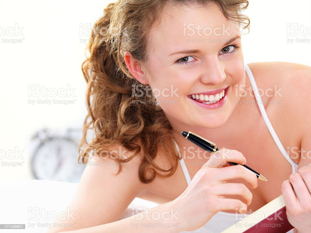 Young girl writing diary royalty-free stock photo