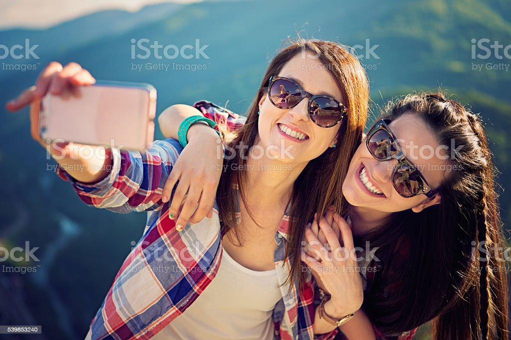 Young girls are taking selfie stock photo