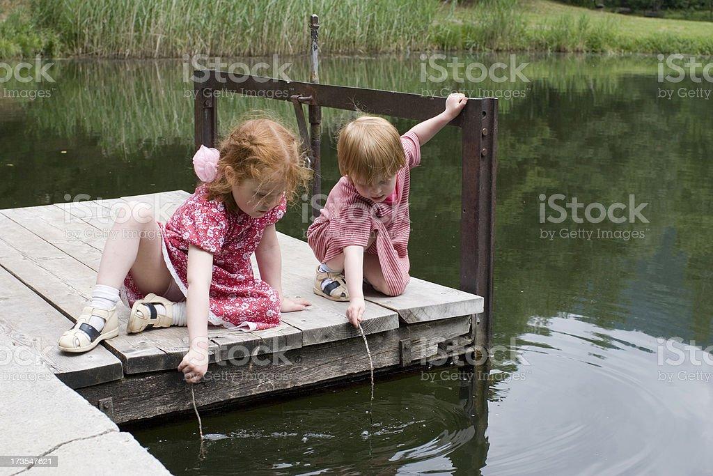 Young girls at lake, making waves royalty-free stock photo