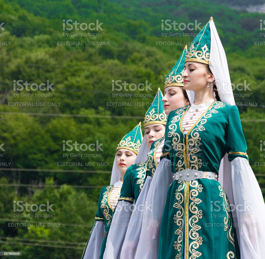 Young girls dancers in traditional Adyghe dresses stock photo