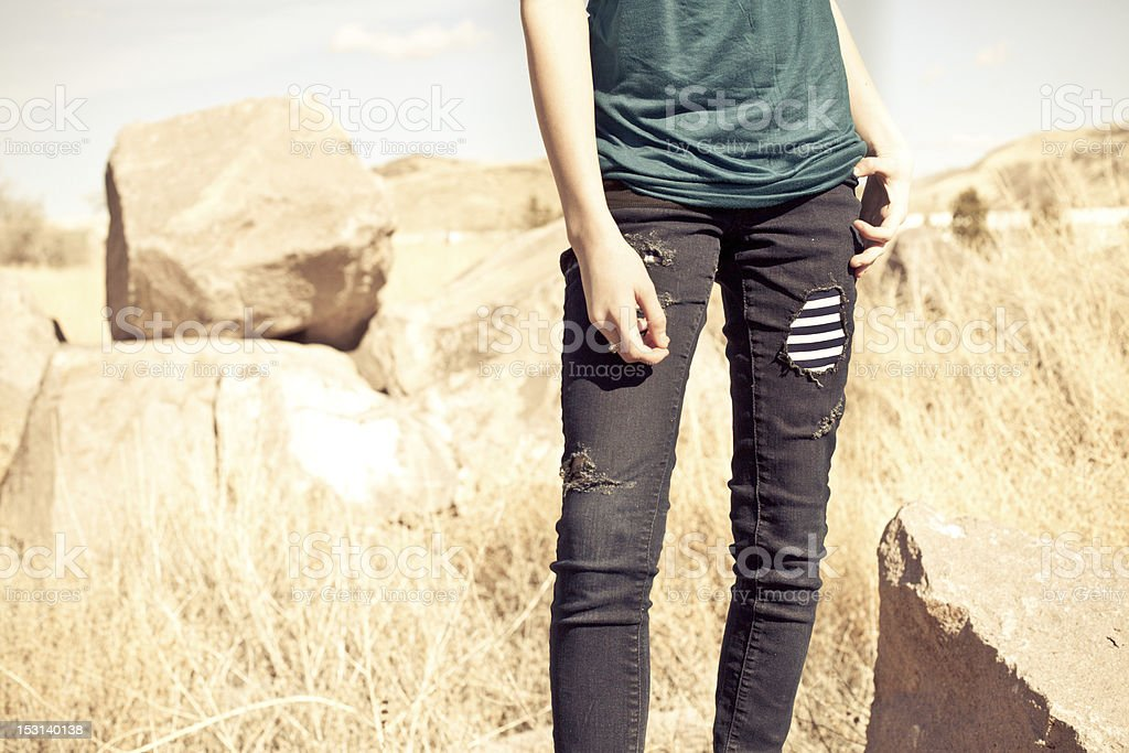 Young Girls Fashion Jeans Closeup from Waist Down royalty-free stock photo