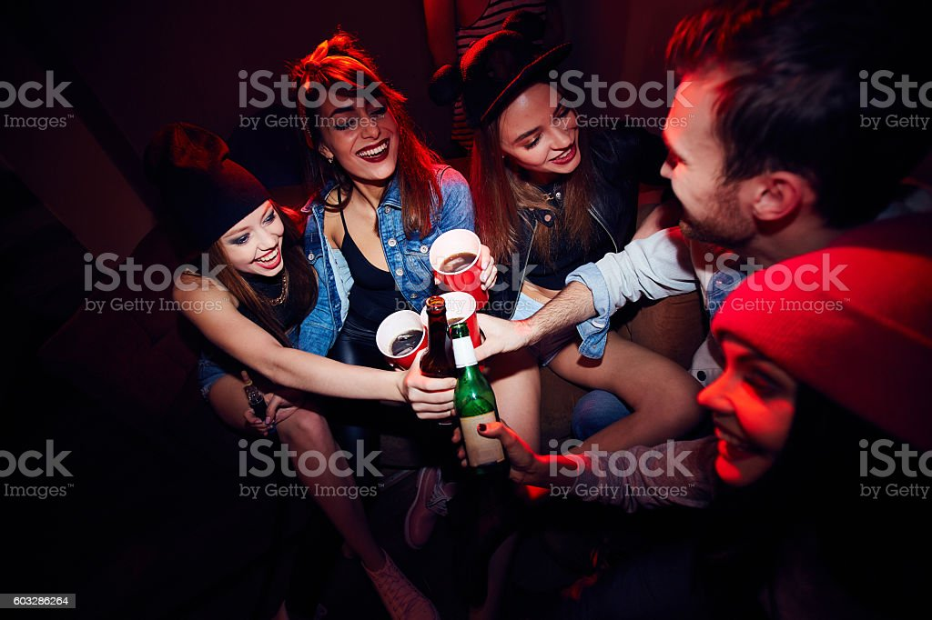 Young Girls Getting Drunk at Party stock photo
