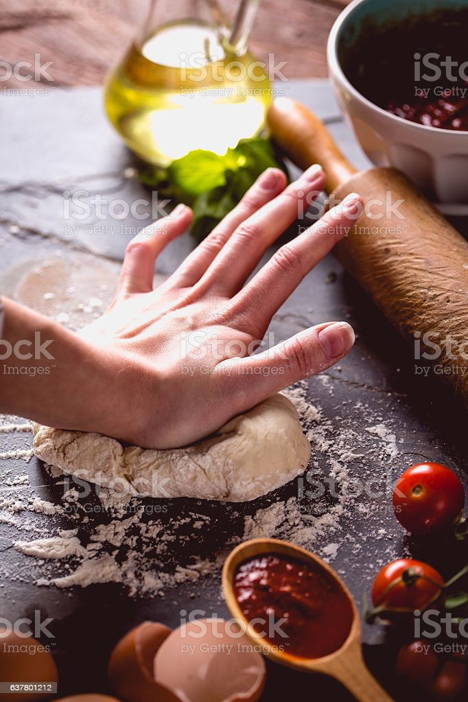 Young girl's hand knead the dough stock photo