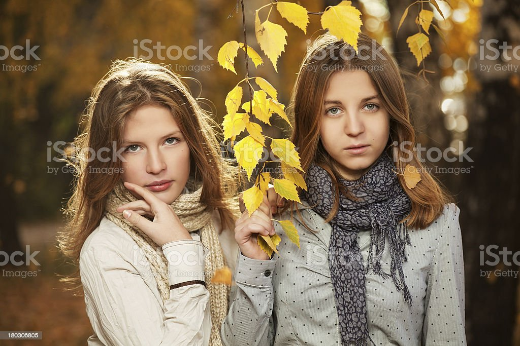 Young girls in an autumn park royalty-free stock photo