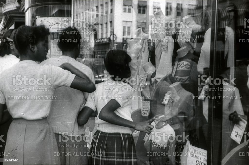 Young girls in front of a shop window in Harlem, 1951 stock photo