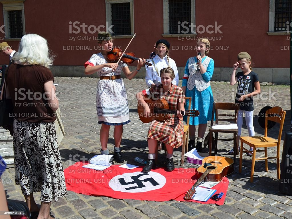 Young girls perform antinazi songs in Warsaw stock photo