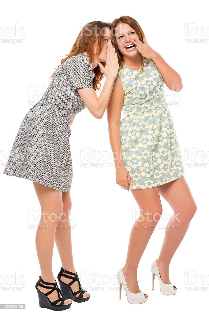 young girls quietly secretive on a white background stock photo