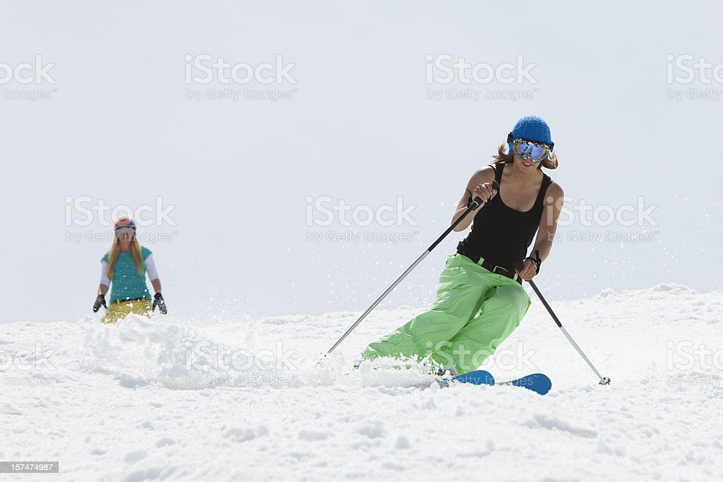 Young girls skiing together. royalty-free stock photo