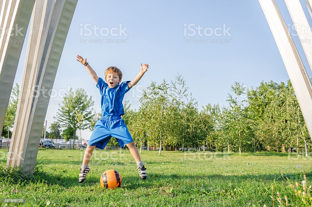 Young goalkeeper missed the ball into the goal stock photo