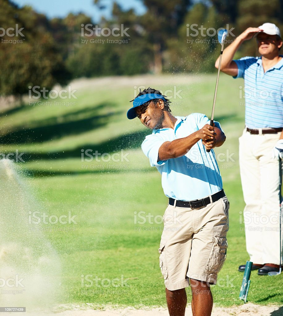 Young golfer during a stroke royalty-free stock photo