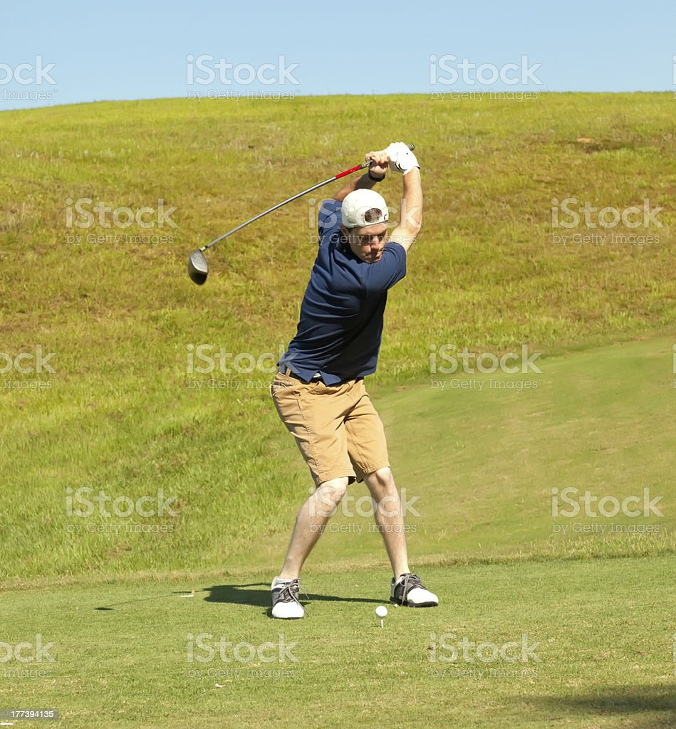 Young Golfer Using the Driver off Tee Box stock photo