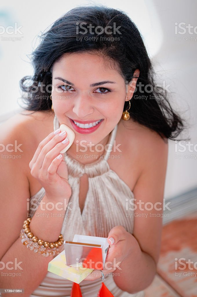 Young gorgeous woman applying make up royalty-free stock photo