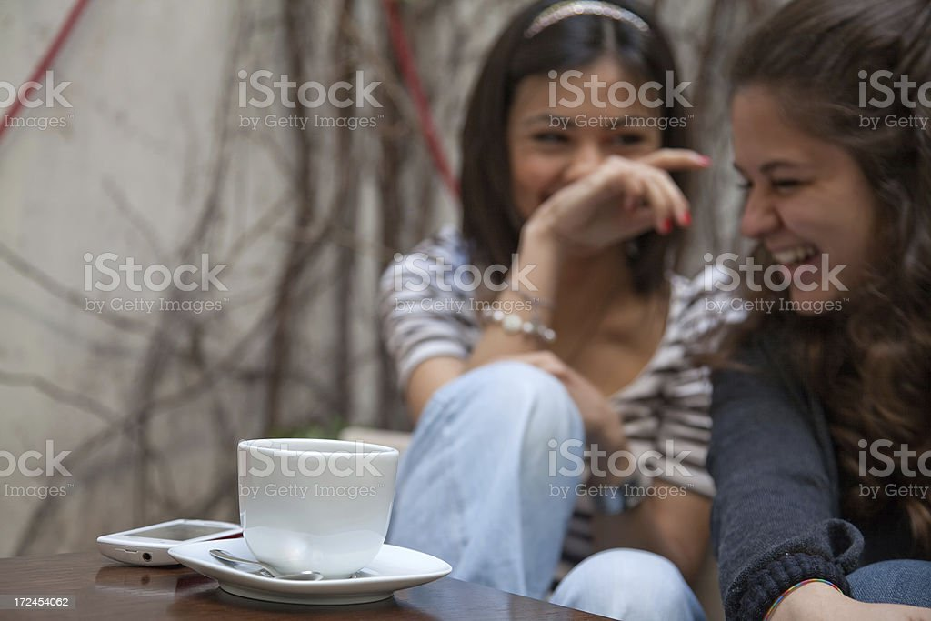 Young gossip girls in cafe royalty-free stock photo
