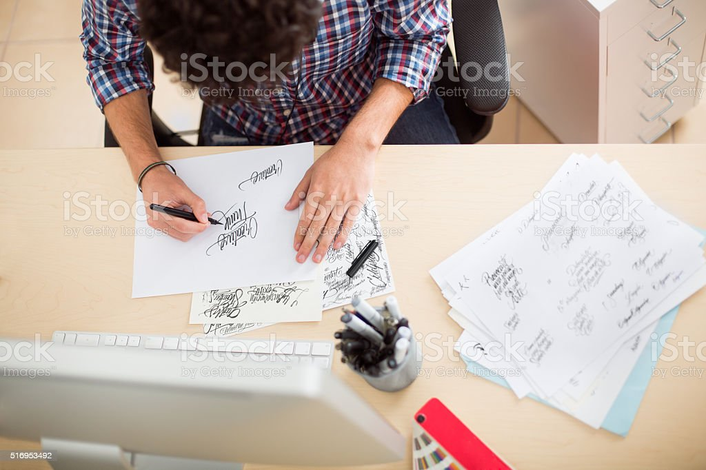 Young graphic designer sketching stock photo