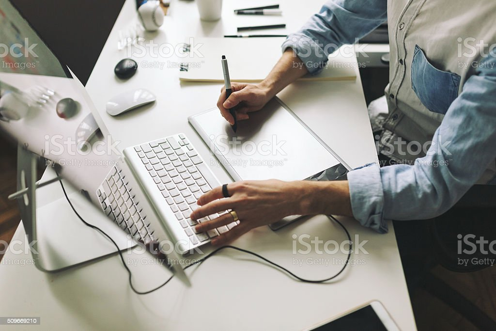 Young graphic designer working in office stock photo