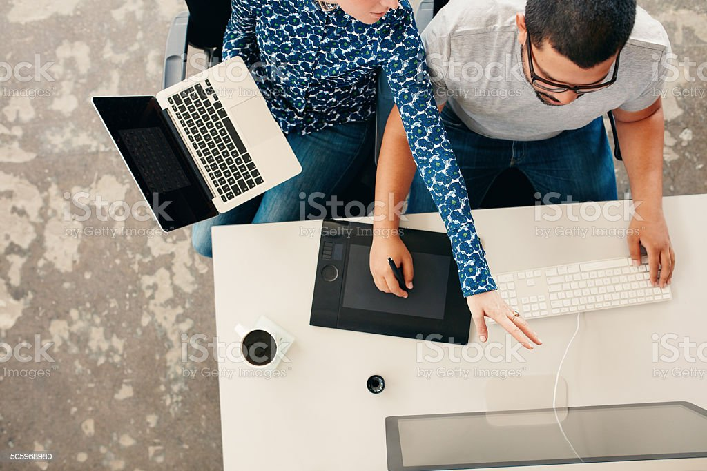 Young graphic designers coworking in office stock photo