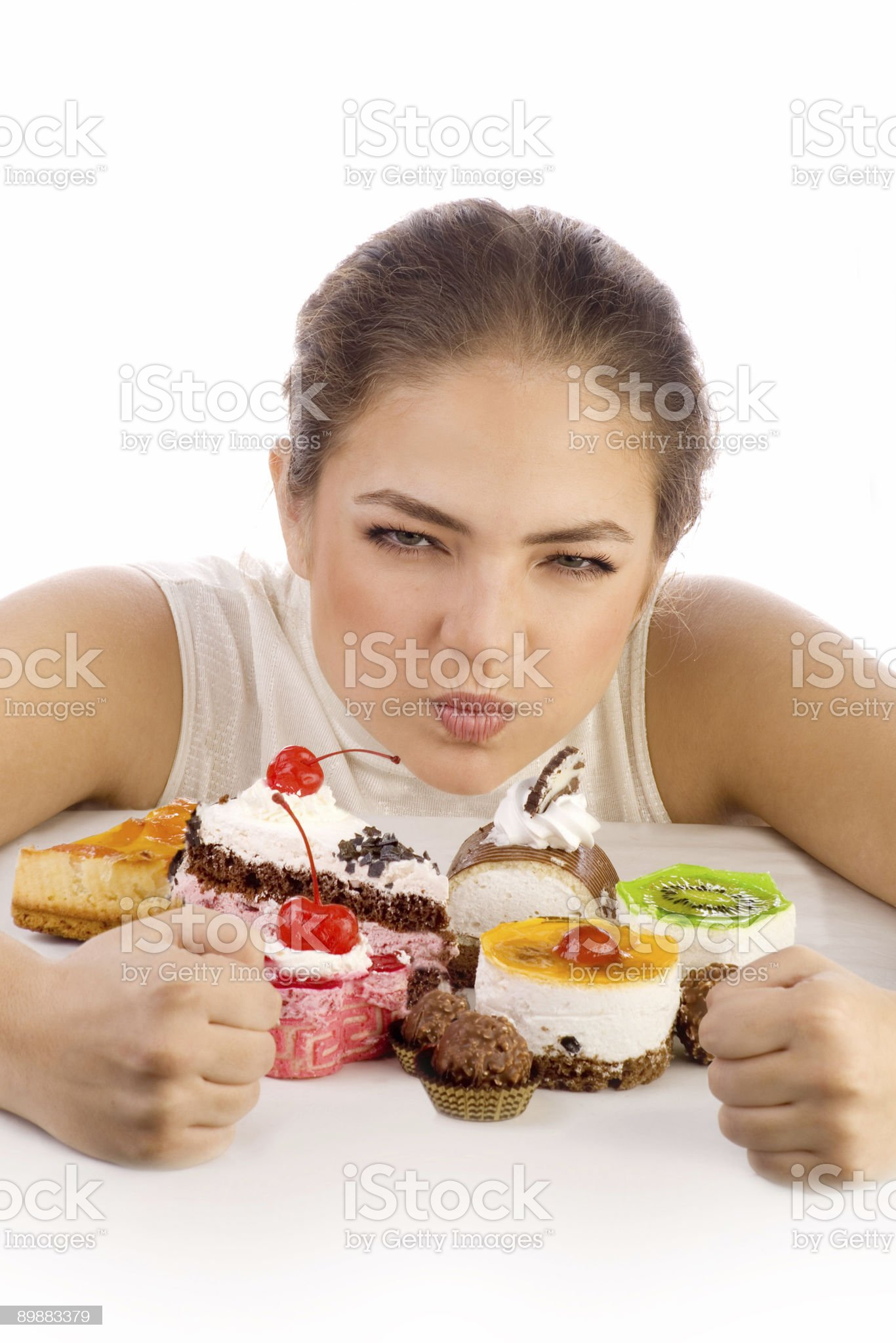Young greedy women protecting cookies royalty-free stock photo
