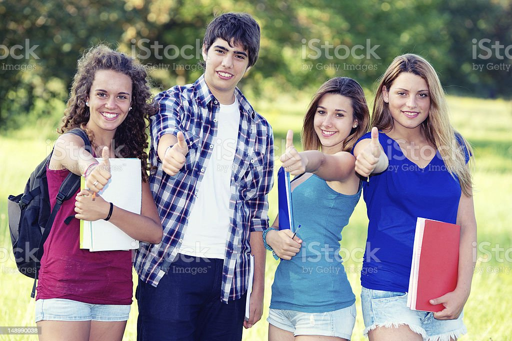Young group of happy students showing thumbs up sign together royalty-free stock photo