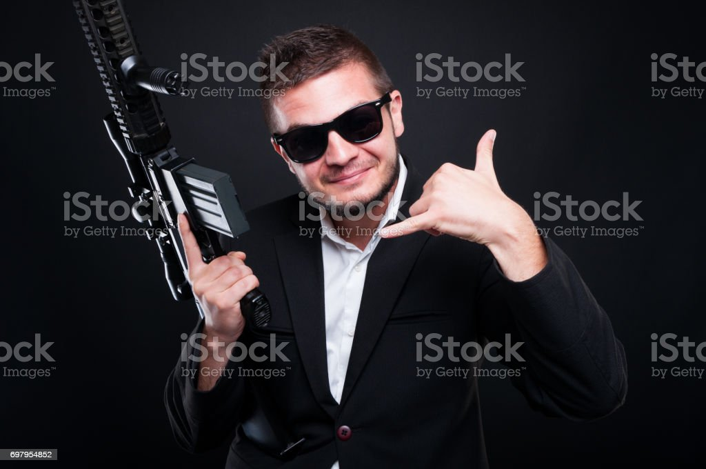 Young gunman doing illegal trade with weapon stock photo