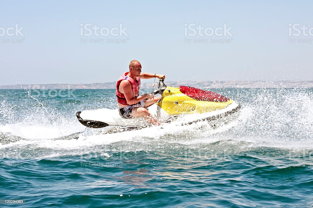 Young guy cruising on a jet ski royalty-free stock photo