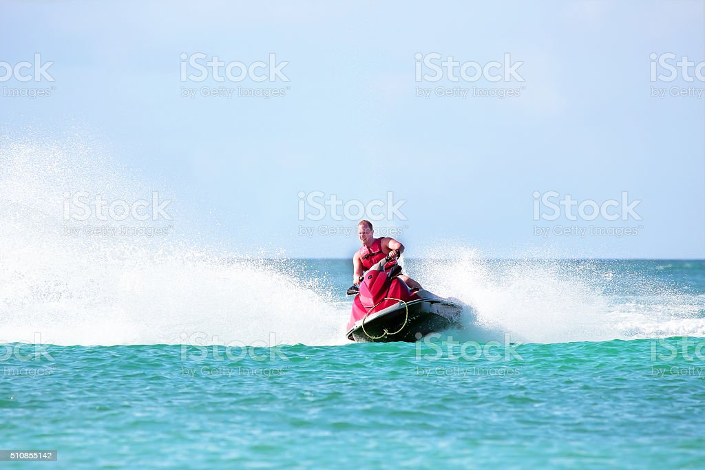 Young guy cruising on a jet ski stock photo