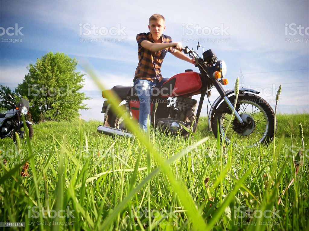 Young guy on bike. Nature stock photo