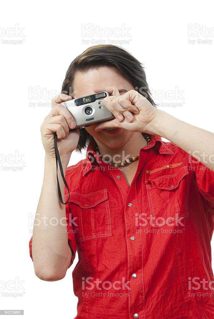 Young guy photographs something. stock photo