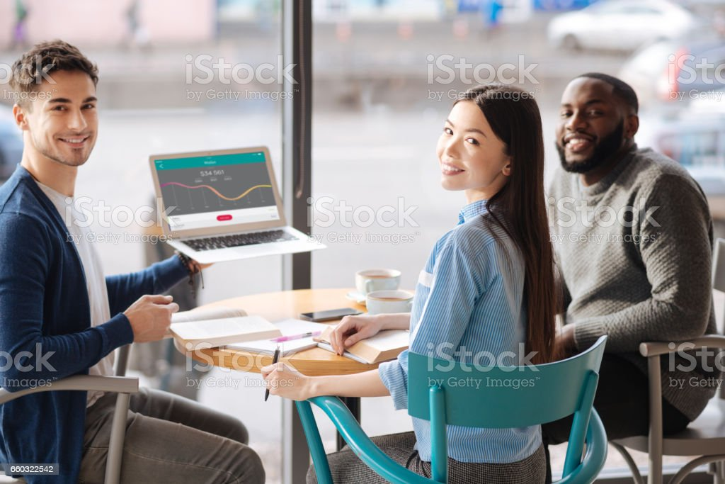 Young guy presenting information from laptop stock photo