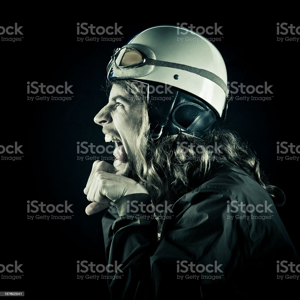 young guy riding an imaginary moped stock photo