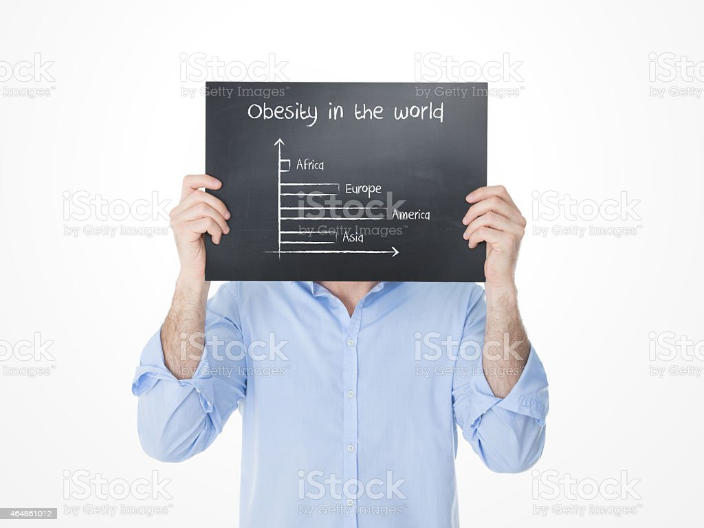young guy showing statics of obesity in the world stock photo
