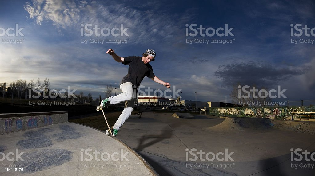 Young guy skateboarding stock photo