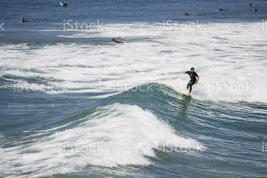 Young guy surfing on the waves  -  California royalty-free stock photo