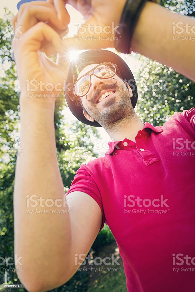 Young guy with mustaches making selfie stock photo