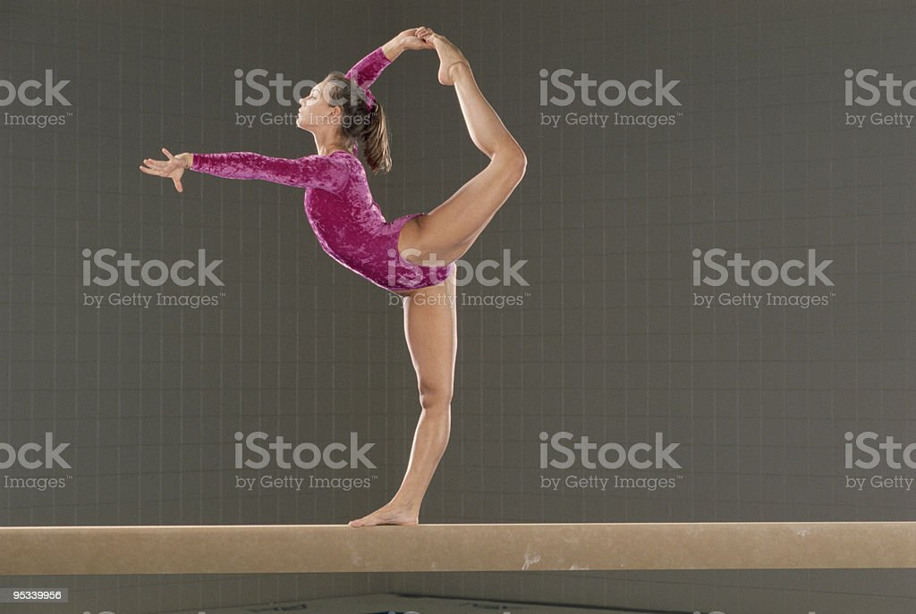 Young gymnast on balance beam stock photo