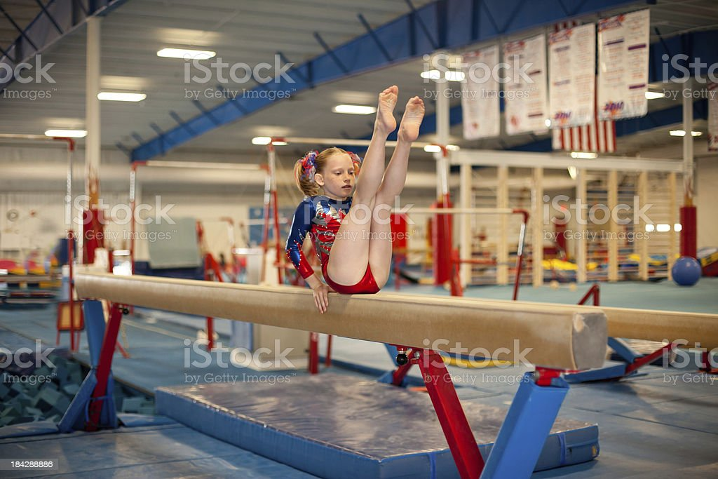 Young Gymnast Practicing Beam Routine royalty-free stock photo